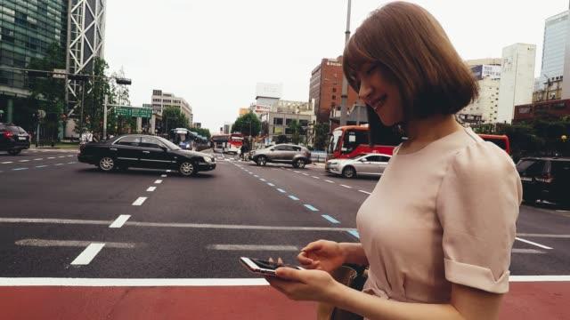Elegant Korean woman in the city of Seoul downtown - video