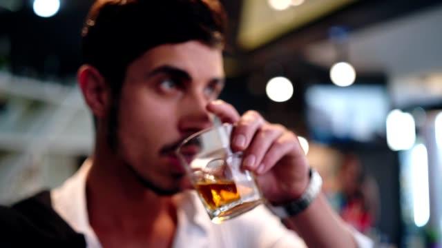 elegant man drinking whiskey in the bar - whisky video stock e b–roll