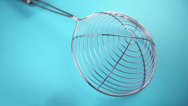 elegant mesh skimmer on light blue background closeup - libellulidae video stock e b–roll