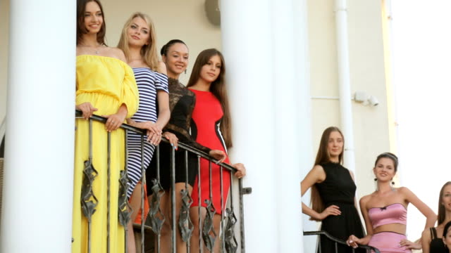 Elegant models posing on the stairs outside video