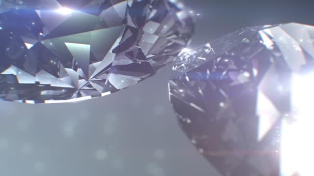 優雅閃亮的無縫環α鑽石和寶石。 - 可循環移動圖像 個影片檔及 b 捲影像