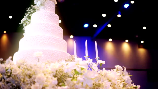 Elegant wedding cake decorated with candles. video