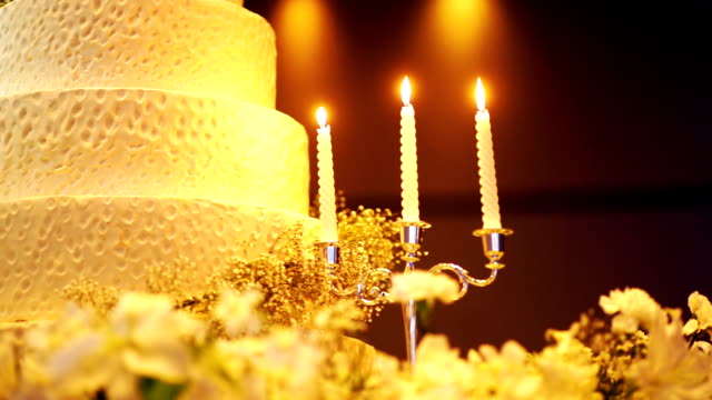 Elegant wedding cake decoration with candles. video