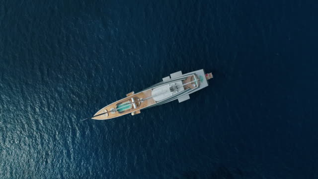Elegant white yacht in the Mediterranean sea, Nissi Beach, Ayia Napa, Cyprus. Aerial drone shot. video