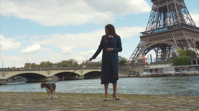 Elegant Woman Walking Her Dog By The Riverside video