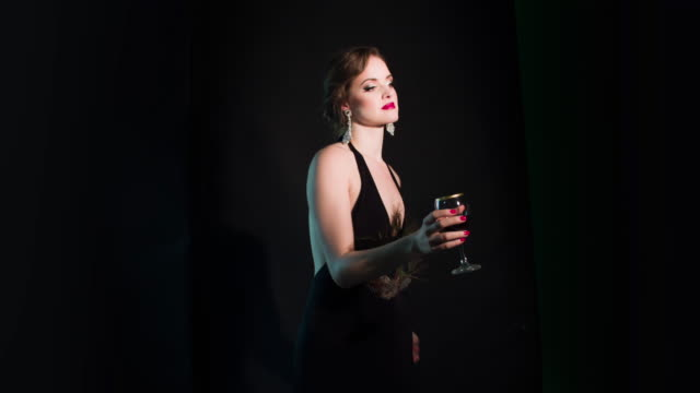Elegant woman with a glass of wine video