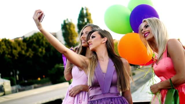 Elegant women taking selfie video