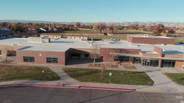 Elementary School Building Aerial footage of an Elementary school building that's empty due to covid-19 school building stock videos & royalty-free footage