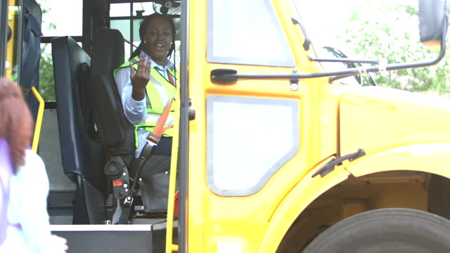 elementary school children board a school bus - bus driver stock videos and b-roll footage