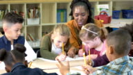istock Elementary school classroom, girl with down syndrome 1197007152
