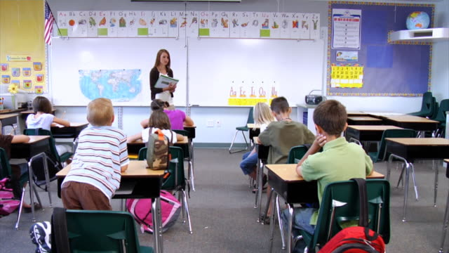 Elementary Classroom Pictures ~ Royalty free elementary school teacher hd video k stock