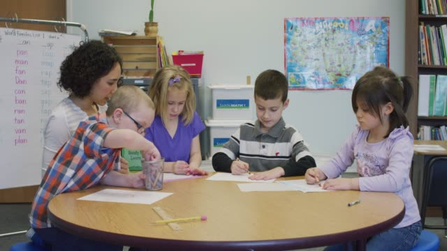 Elementary Students Coloring at a Circular Table video