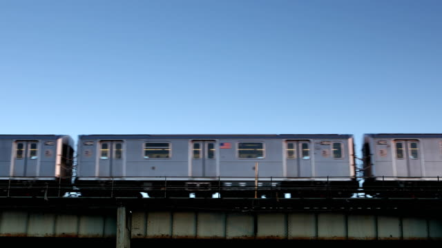 Elevated 7 Train Subway in Queens New York City Outdoor subway train on elevated tracks passing through  Queens in New York City. underground stock videos & royalty-free footage