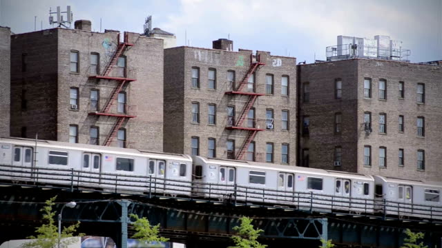 Elevated Subway Train in Bronx New York City Ghetto NYC subway train on elevated track in Bronx, NY, USA poverty stock videos & royalty-free footage