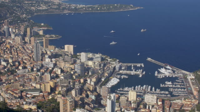 Elevated view of Monaco on the French Riviera. 4K resolution. Pan L to R. monte carlo stock videos & royalty-free footage