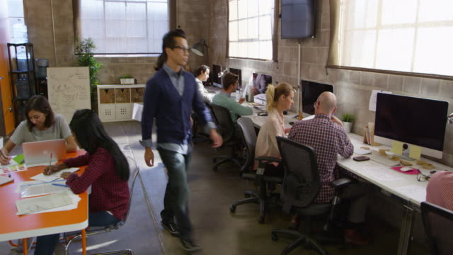 elevated view of people working in modern design office shot on r3d - office stock videos & royalty-free footage