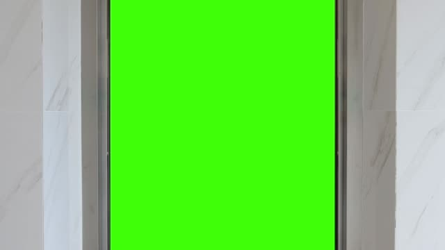 elevator open to green screen - ascensore video stock e b–roll