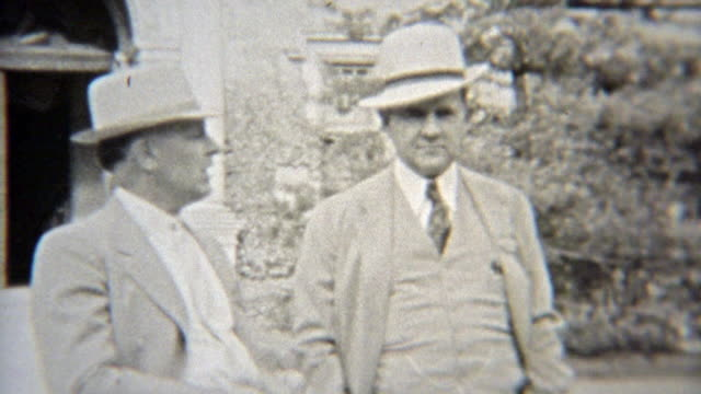 1937: Elite businessmen in formal fashion dress with fedora hats. video