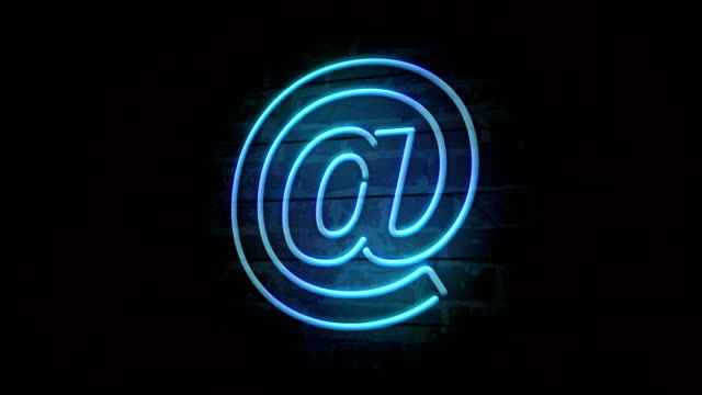E-mail at neon symbol on brick wall E-mail at @ neon symbol on brick wall. Internet communication sign light on brick wall background. Retro style glowing icon. email icon stock videos & royalty-free footage