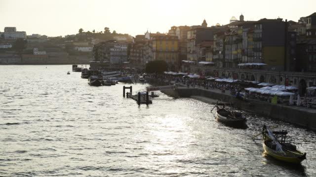 vallen i porto - walking home sunset street bildbanksvideor och videomaterial från bakom kulisserna