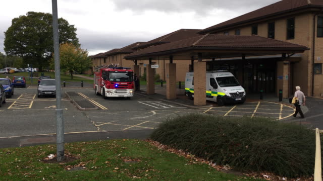 Emergency call in Hospital Fire engine with lights on attending an emergency call at an NHS hospital in the UK nhs stock videos & royalty-free footage