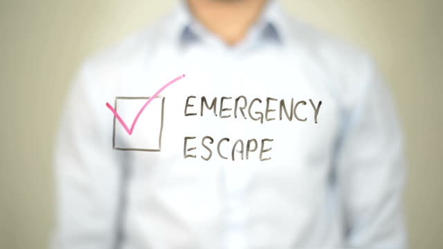 Emergency Escape,  Man writing on transparent screen video