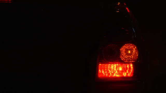 Emergency flashing car rear light lamp at night Emergency flashing car rear light lamp at night. Camera zooming tail stock videos & royalty-free footage