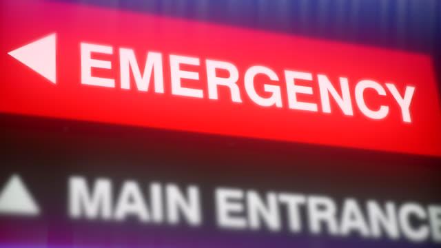 emergency medical hospital sign, health care clinic sign, zoom camera - ultra high definition television filmów i materiałów b-roll