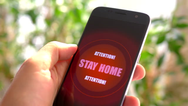 Emergency message Stay Home on the phone Emergency message Stay Home on the phone warning sign stock videos & royalty-free footage