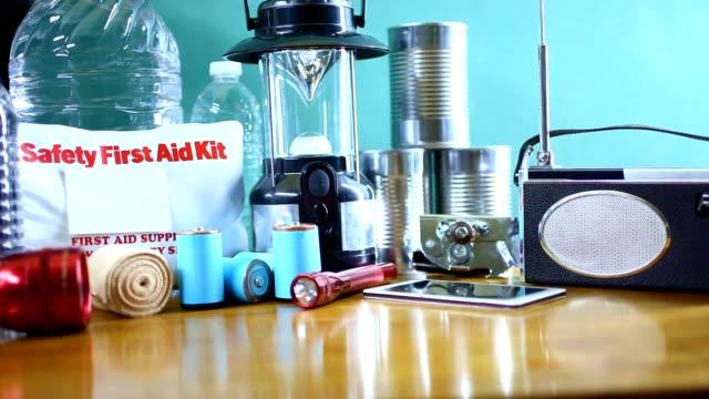 Emergency preparedness natural disaster supplies.  Water, flashlight, lantern, radio, batteries, first aid kit. video