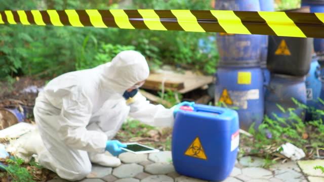 Emergency Team checking Biohazard Leak Emergency Team checking Biohazard Leak poisonous stock videos & royalty-free footage