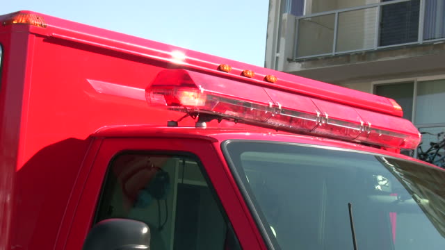 (HD1080i) Emergency Vehicle, Front Angled View with Flashing Red Lights video