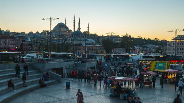 eminonu bazaar day to night time lapse in istanbul, turkey - турция стоковые видео и кадры b-roll