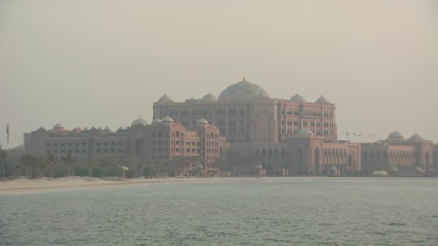 Emirates Palace Hotel, Abu Dhabi Emirates Palace Hotel, Abu Dhabi. Wide hazy view from the Gulf Sea of the Emirates Palace Hotel. palace stock videos & royalty-free footage
