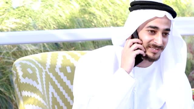 Emirati Arab talking on the phone - 4k video