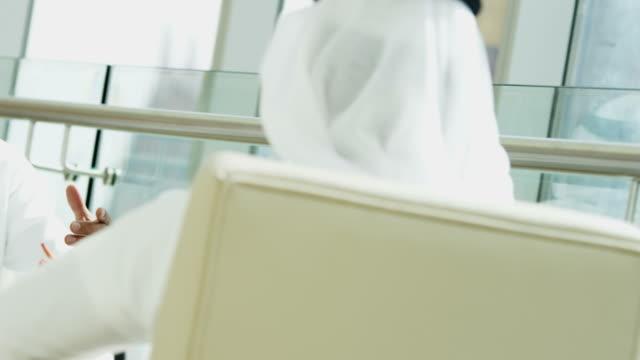 Emirati business travellers handshake meeting downtown Dubai hotel video