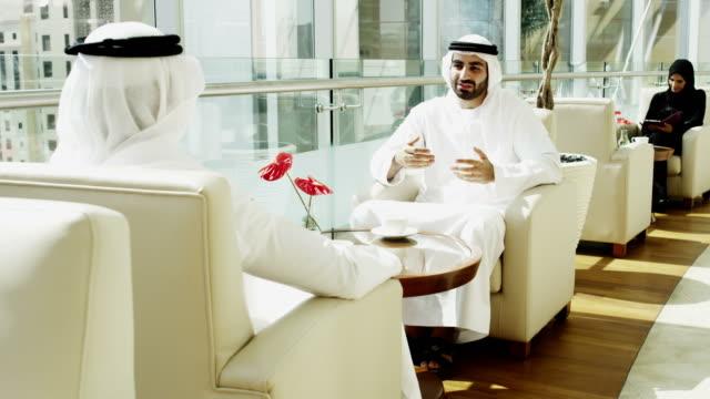 Emirati business travellers shaking hands downtown Dubai hotel video