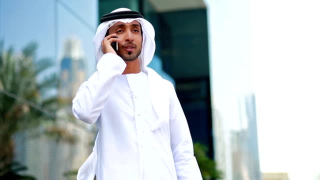 Emirati businessman talking on the phone video