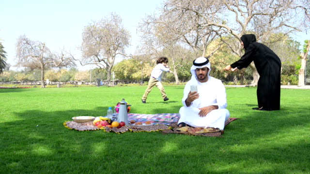Emirati family having fun at picnic video