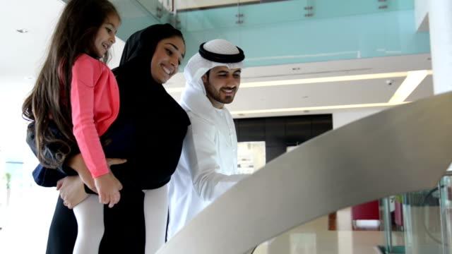 Emirati family using information display
