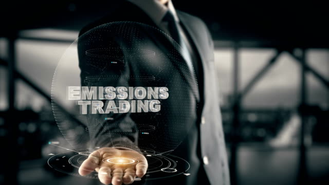 Emissions Trading with hologram businessman concept video