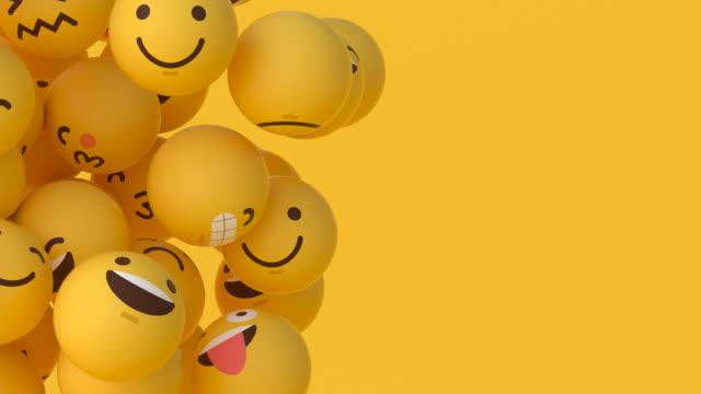 emoji topları-yüzen #3 (sol) - sarı stok videoları ve detay görüntü çekimi