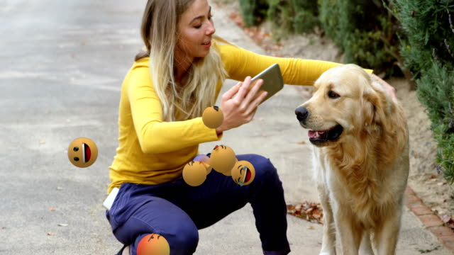 Emoji icons with a woman taking selfie with her dog in the background 4k