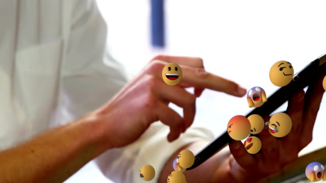 Emoji icons with a woman using tablet in the background 4k