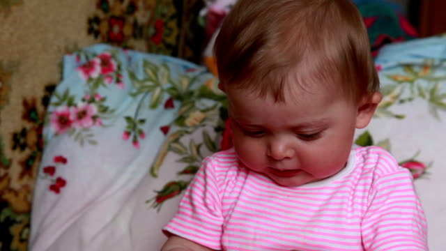 Emotional baby playing on the bed video