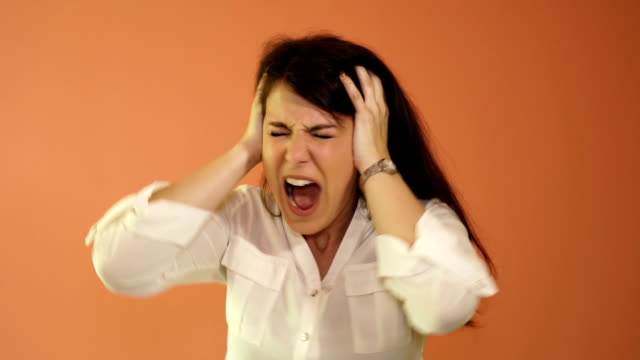 emotional portrait of a crazy women. the nervous breakdown, mental disease, headaches and migraine video