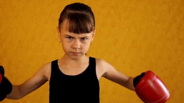 emotions of the child in boxing gloves - guanto indumento sportivo protettivo video stock e b–roll
