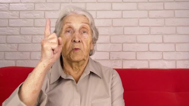Emotions of the elderly Emotions of the elderly. An elderly woman swears. grandmother stock videos & royalty-free footage