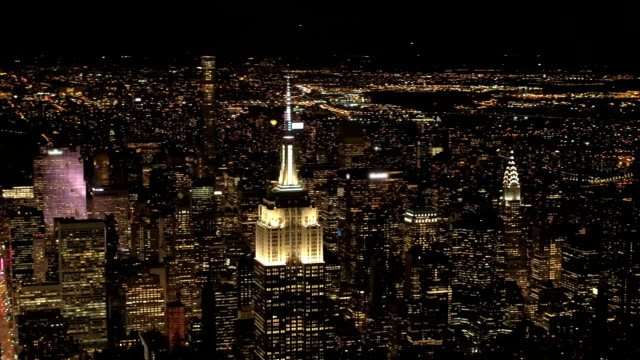 AERIAL: Empire State Building at night looking toward Upper Manhattan & Queens video