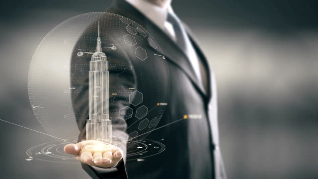 Empire State Building Businessman holding in Hand Landmark New technologies